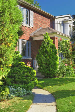 City home in red brick exterior with garden and path Stock Photo - 10905672