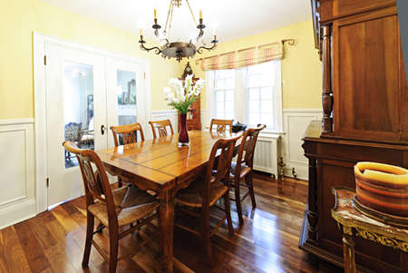 Dining room interior with wooden table and chairs in house Stock Photo - 10943405