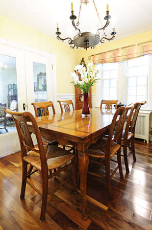 Dining room interior with antique wooden table and chairs in house photo