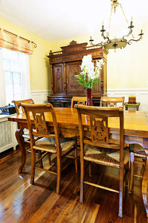 old furniture: Dining room interior with antique wooden table and chairs in house Stock Photo