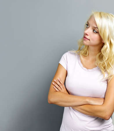 arms up: Portrait of young blonde caucasian woman looking to the side and up Stock Photo