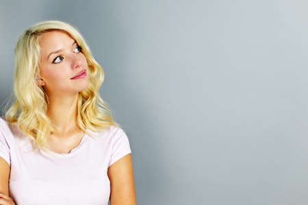 Portrait of young blonde caucasian woman looking to the side and up Stock Photo - 10943373
