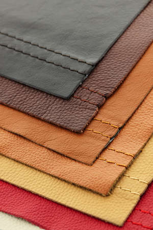 Natural leather upholstery samples with stitching in various colors Stok Fotoğraf - 10943410
