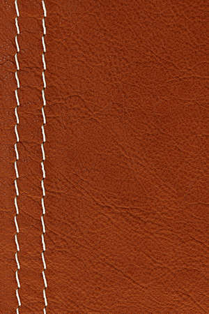stitched: Leather background in brown with white stitches Stock Photo