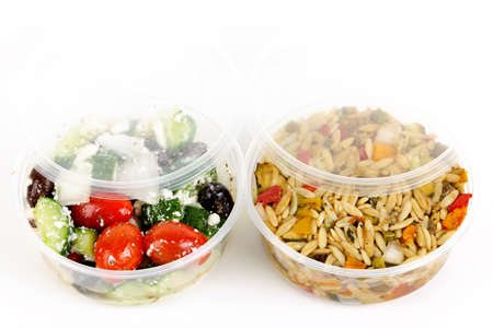 Deli: Two servings of prepared salad in plastic takeaway containers Stock Photo