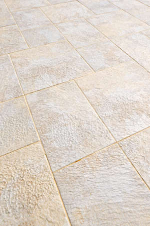 floor tiles: Ceramic tile flooring close up as background Stock Photo