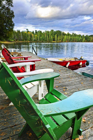 Deck chairs at dock on Lake of Two Rivers in Algonquin Park, Ontario, Canada photo