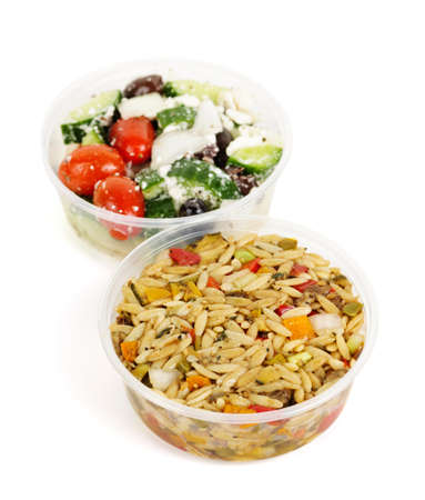 Two servings of prepared salad in plastic takeaway containers Stock Photo - 11106465