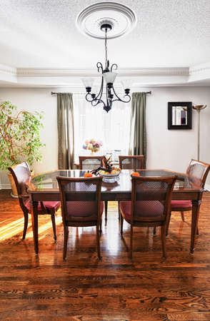 dining room: Dining room interior with wooden table and chairs in house