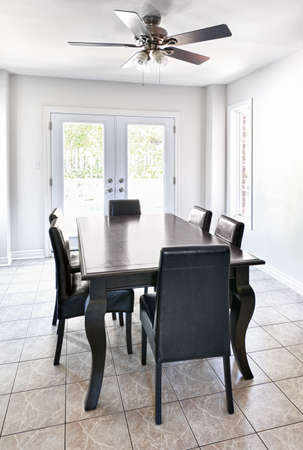 tile flooring: Room with dining table and chairs in upscale home