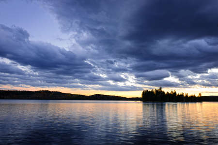 Dramatic sunset at Lake of Two Rivers in Algonquin Park, Ontario, Canada photo