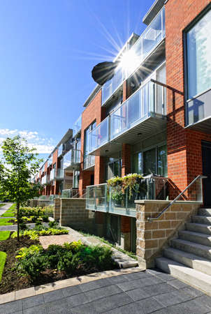 lowrise: Modern town houses of brick and glass on urban street