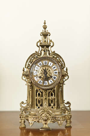 metalwork: Antique bronze shelf clock with ornate decoration