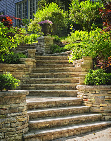 Natural stone stairs landscaping in home garden photo