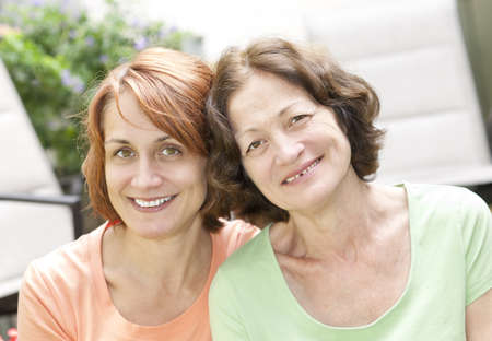 Family portrait of smiling mature mother and daughter Stock Photo - 12389868
