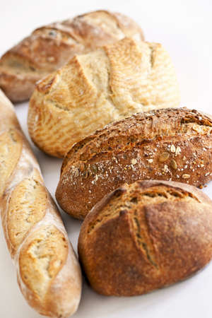 crusty french bread: Assorted kinds of fresh baked bread in a row
