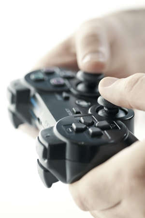 controller: Male hands holding video game controller closeup