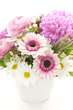 vase: Bouquet of colorful flowers arranged in small vase