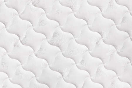 white fabric texture: Background of soft comfortable quilted white mattress