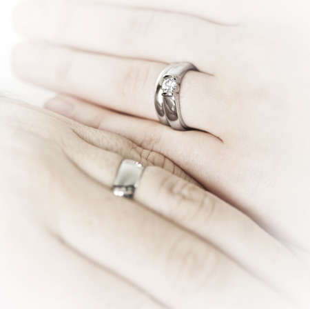 wedding ring hands: Closeup on hands of married couple with wedding rings Stock Photo
