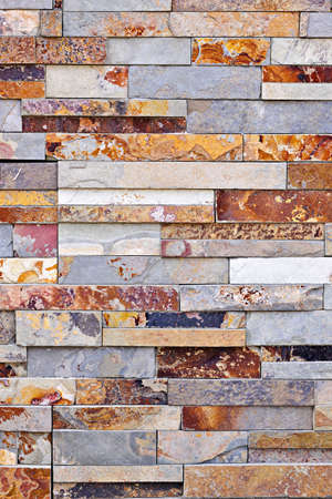 facing: Background of natural slate stone veneer wall Stock Photo