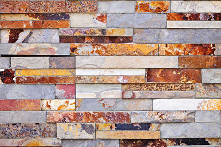 stacked stone: Background of natural slate stone veneer wall Stock Photo