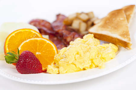 Delicious breakfast of scrambled eggs toast and bacon photo