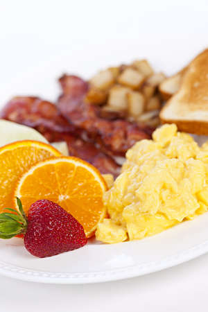 Delicious breakfast of scrambled eggs toast and bacon Stock Photo - 13306539