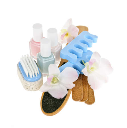 nail polish bottle: Pedicure accessories with nail polish on white background