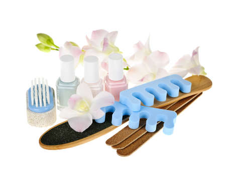 emery: Pedicure accessories and nail polish on white background
