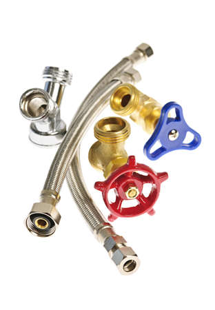 fittings: Isolated plumbing valves hoses and assorted parts Stock Photo