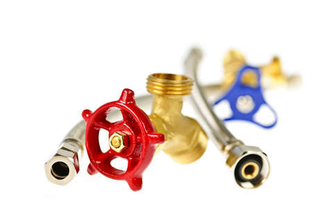 Isolated plumbing valves hoses and assorted parts Фото со стока