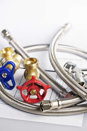 Plumbing valves hoses and assorted parts with estimate sheet Stock Photo - 13306540