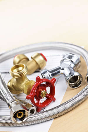 Plumbing valves hoses and assorted parts with estimate sheet Stock Photo - 13306542