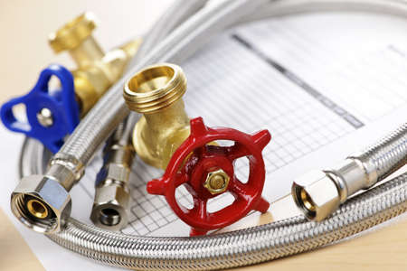 plumbing supply: Plumbing valves hoses and assorted parts with estimate sheet