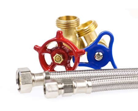 pipe connector: Blue and red plumbing valves with metal hoses Stock Photo