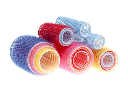 hair rollers: Rodillos de pelo de colores apiladas aisladas sobre fondo blanco Foto de archivo