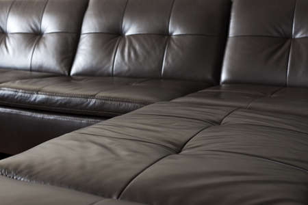 couch: Closeup of luxurious expensive black leather couch