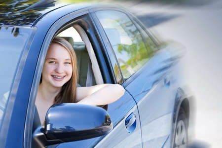 test drive: Teenage female driving student learning to drive a car