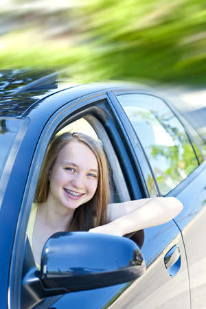Teenage female driving student learning to drive a car photo