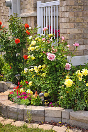 flowerbeds: Natural stone landscaping in home rose garden