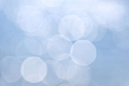 Abstract defocused background in blue and white photo