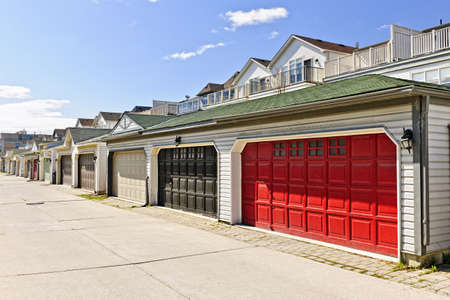Row of garage doors at parking area for townhouses