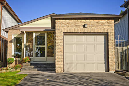 Suburban small bungalow house with single garage photo