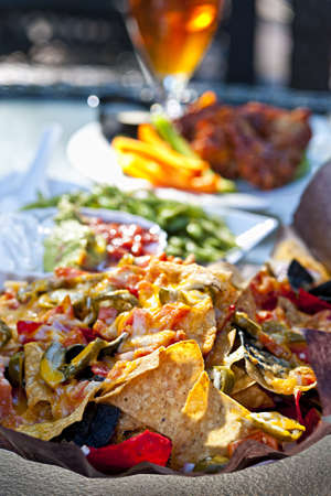 NACHO: Basket of nachos and other appetizers on restaurant table