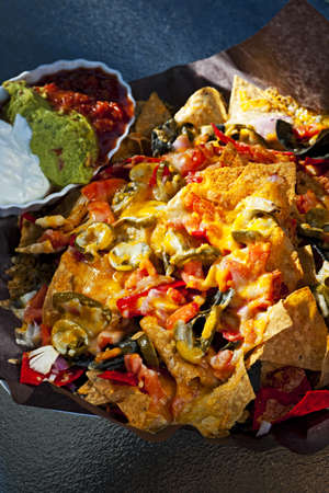 NACHO: Basket of nachos with cheese jalapeno and toppings