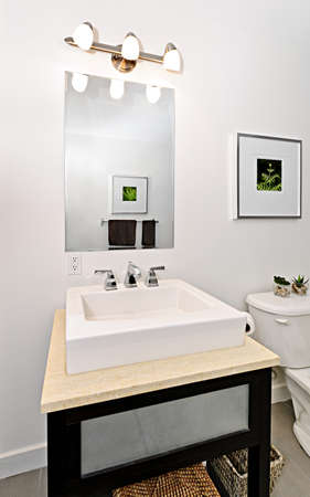 Interior bathroom vanity and mirror - artwork on walls are from photographer portfolio photo