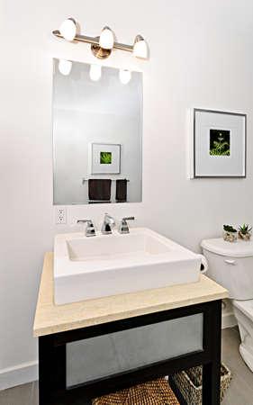 bathroom mirror: Interior bathroom vanity and mirror - artwork on walls are from photographer portfolio