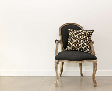 vintage furniture: Antique armchair furniture with cushion against white wall Stock Photo