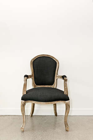 baroque room: Antique upholstered armchair furniture against white wall Stock Photo